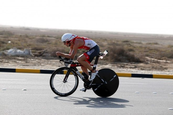 BAHRAIN, BAHRAIN - DECEMBER 05:  Bart Aernouts  of Germany during the bike section of Ironman Bahrain on December 5, 2015 in Bahrain, Bahrain.  (Photo by Nigel Roddis/Getty Images for Ironman)