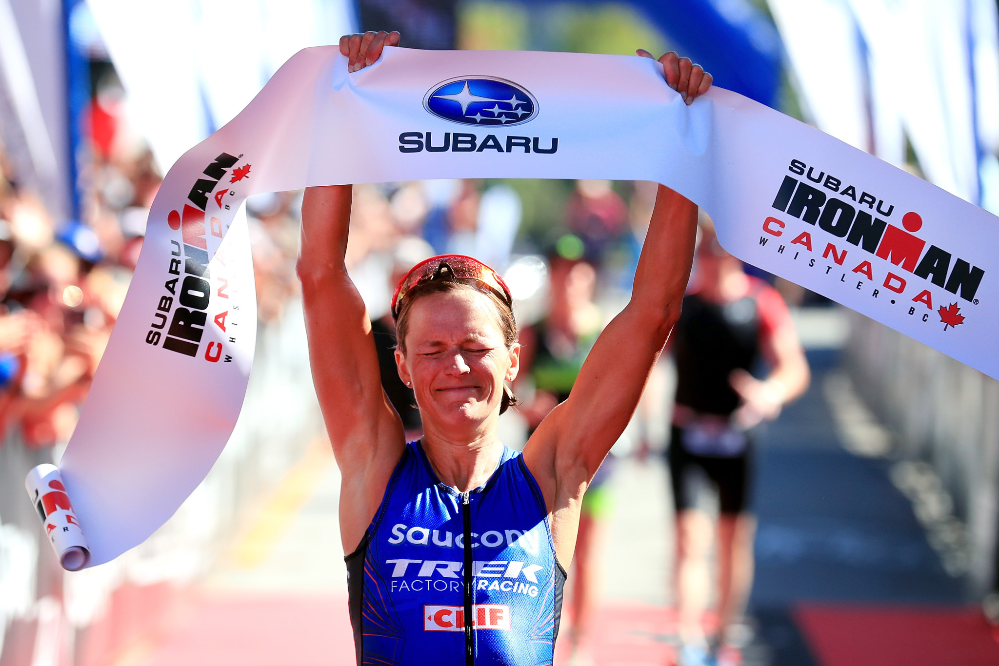 WHISTLER, BC - JULY 30:  Linsey Corbin of the United States celebrates after crossing the finish line to win the Pro Women's Division in the Subaru Ironman Canada triathlon on July 30, 2017 in Whistler, Canada.  (Photo by Tom Pennington/Getty Images for IRONMAN)